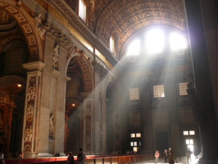 Light streams through the windows inside St. Peter's Basilica, The Vatican City.